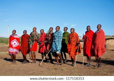 MAASAI MARA, KENYA - OCT 15: Group of unidentified Maasai men on Oct 15, 2012 in Maasai Mara, Kenya. Maasai are a Nilotic ethnic group of semi-nomadic people located in Kenya and northern Tanzania.