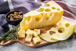 Maasdam cheese with walnut and thyme. White background. Top view