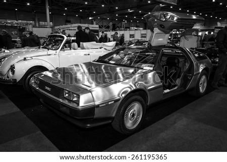 MAASTRICHT, NETHERLANDS - JANUARY 09, 2015: Sports car DeLorean DMC-12. Black and white. International Exhibition InterClassics & Topmobiel 2015