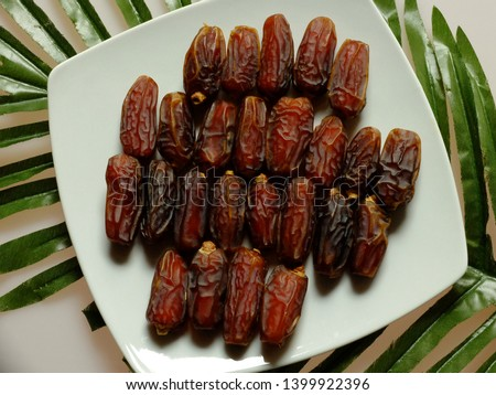 Mabroom dates fruit. dates fruit consumed by Muslims throughout the world when breaking fast during the month of Ramadan. Mabroom dates from the city of Medina, the Kingdom of Saudi Arabia. #1399922396