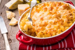Mac and cheese, american style macaroni pasta in cheesy sauce
