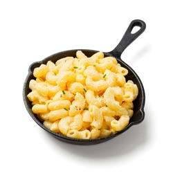 Mac and cheese, american style macaroni pasta with cheese sauce. isolated on white background