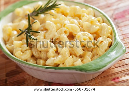 Mac and cheese, american style macaroni pasta with cheesy sauce