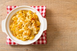 mac and cheese, macaroni pasta in cheesy sauce - American style