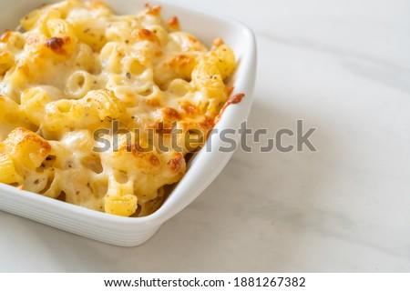 mac and cheese, macaroni pasta in cheesy sauce - American style Stock photo ©