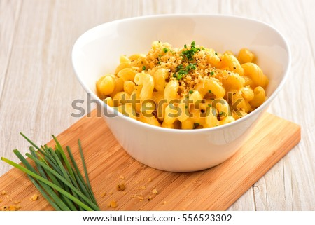 Mac and Cheese with Bread Crumbs, Chive Garnish, on Dark Wood Surface and Light Wood Surface.