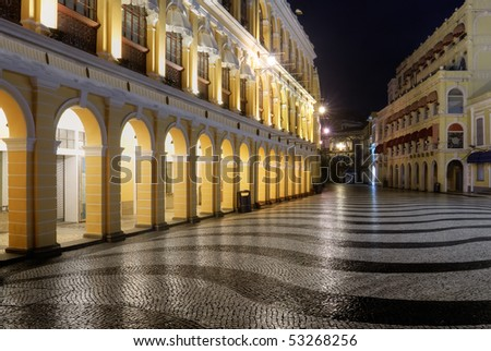 Macao landmark - Senado Square with European buildings and elegant wavy patterns in night.
