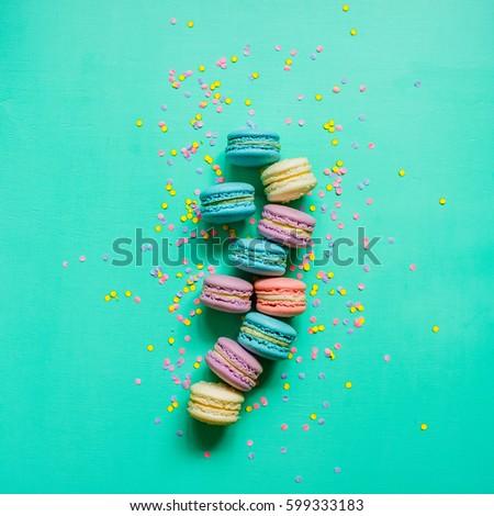 macaron dessert on a turquoise background