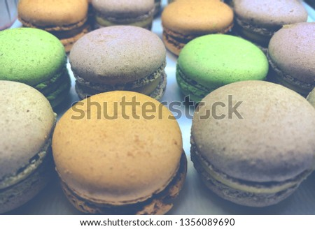 Macaron or French macaroon is a sweet meringue-based confection made with egg white, icing sugar, granulated sugar, almond powder or ground almond, and food coloring.