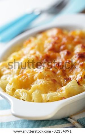 Macaroni and cheese in the white baking dish closeup