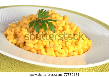 Macaroni and cheese with parsley on top (Selective Focus, Focus on the front of the leaf)