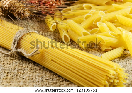 Macaroni and spaghetti on a jute texture