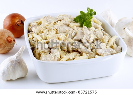 Macaroni casserole with chicken goulash and garlic sauce