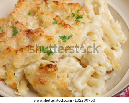 Macaroni cheese in beige bowl.
