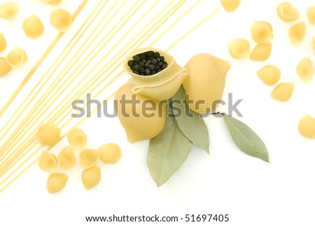 Macaroni, pepper and bay leaf - stock photo