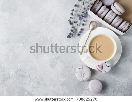Macarons in box and on table with cup of coffee and lavender. Copy space. Top view #708625270
