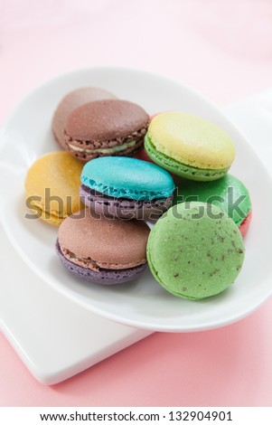 macarons in dish on pink table
