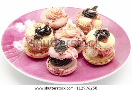 Macarons, traditional Parisian cookie decorated with cream and chocolate