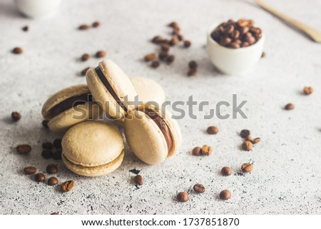 Macaroons. Delicious french desserts. Macaroons with coffee beans and chocolate. Macaroons on the table