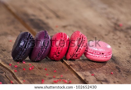 Macaroons on a wooden rustic table