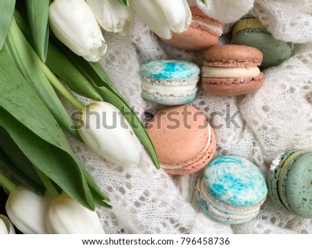 macaroons on white knitted background. fresh macaroons. shabby macaroon wallpaper. macaroon flatlay.