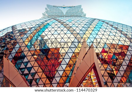 MACAU, CHINA - AUGUST 1, 2012: street view of Grand Lisboa Casino exterior on August 1, 2012 in Macau center. Macau is the gambling capital of Asia and is visited by over 25 million people every year