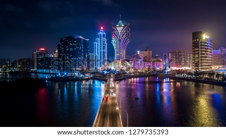 Macau cityscape at night, all hotel and tower are colorful lighten up with blue sky, Macau, China. #1279735393