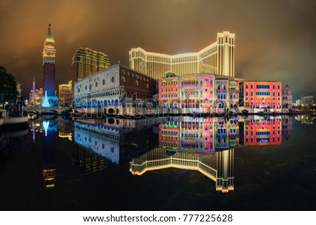 Macau cityscape. Landscape of Macau business building with reflection at night. Macaw city decorated with colorful light.