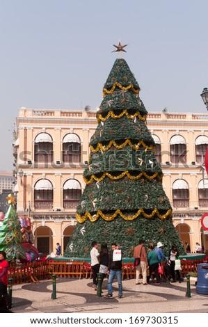 MACAU, MACAU - JANUARY 3,2014 - large Christmas tree in the centre of Senado Square of Macau. This square is the largest in Macau. Macau is a former Portuguese colony.
