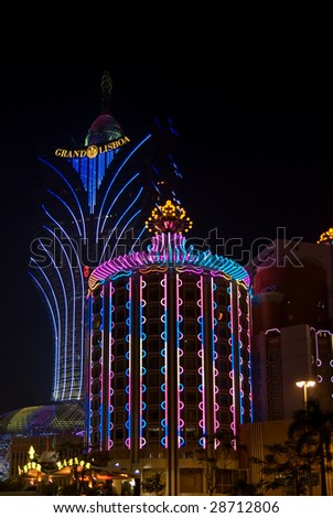 MACAU - NOVEMBER 22 : Night view of casinos neon signs November 22, 2008 in Macau. Macau, formerly a Portuguese colony is the gambling capital of Asia.