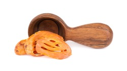Mace in a wooden spoon, isolated on white background. Nutmeg flower, myristica fragrans. Natural spice, asian seasoning.