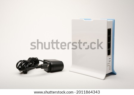 Machachi, Ecuador - July 06, 2021: Mikrotik hAP lite Rb941-2nd-tc Router with voltage adapter, isolated on white Stok fotoğraf ©