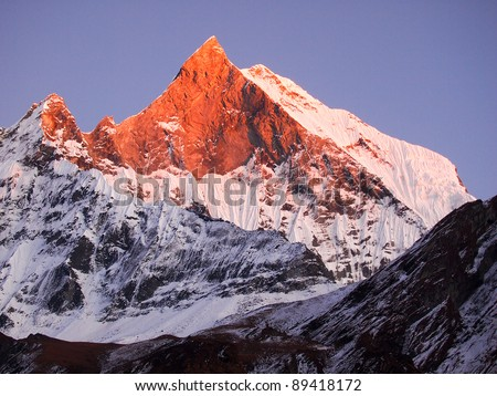 Machapuchare (Fish Tail), is a mountain in the Annapurna Himal of north central Nepal. It is revered by the local population as particularly sacred to the god Shiva.