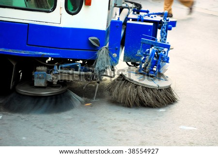 machine cleaning dust from sidewalk in barcelona