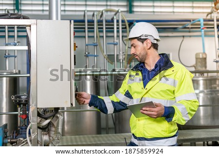 Machine engineers inspect machines and sterilizers in food factories or factory drinking water plants. Machine maintenance Photo stock ©