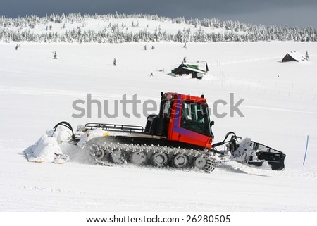 machine for snow preparation working at small ski slope