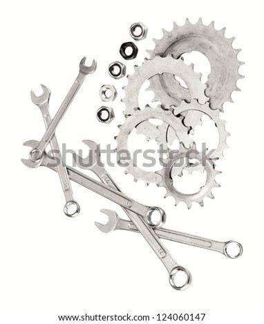 Machine gear, metal cogwheels, nuts and bolts isolated on white