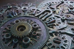 Machine gear, metal cogwheels, nuts and bolts.Selective focus