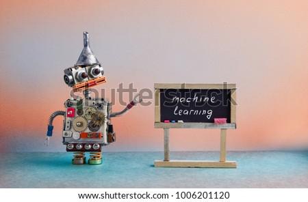 Machine learning concept. Robot creative design toy metal funnel hopper, cogs wheels gears metallic body. Black chalkboard classroom interior, futuristic colors background.