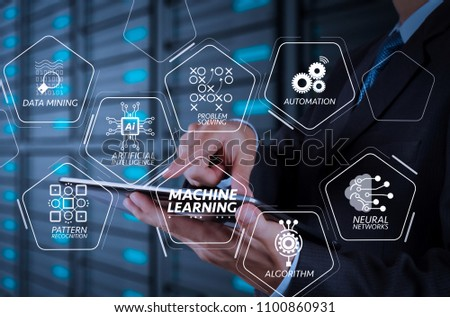 Machine learning technology diagram with artificial intelligence (AI),neural network,automation,data mining in VR screen.businessman hand using tablet computer and server room background #1100860931