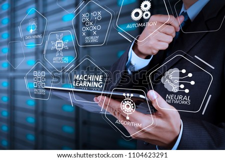 Machine learning technology diagram with artificial intelligence (AI),neural network,automation,data mining in VR screen.businessman hand using tablet computer and server room background #1104623291
