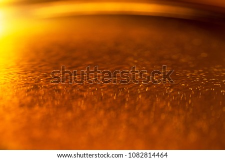 Machine oil on a metal gear engine surface. Closeup photo. #1082814464