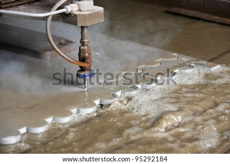 Machine using water pressure to cut through stainless steel materials