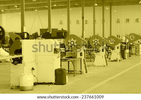 Machinery and equipment in the workshop, in a solar equipment manufacturing enterprises on december 22, 2013, tangshan, china.
