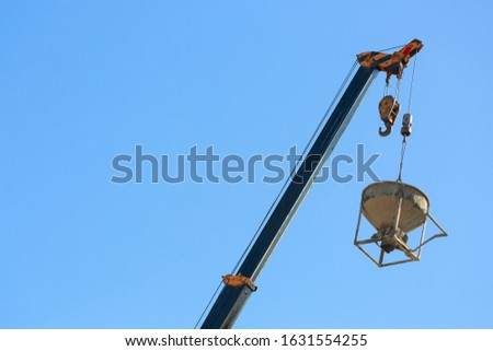 machinery crane hoisting cement mortar mixer bucket container in construction site building industry