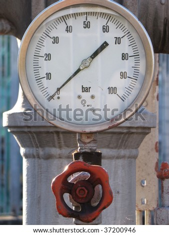 machinery under pressure  into a rafinery plant - stock photo