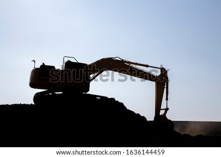Machinery working heavy silhouette tractor