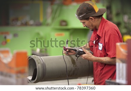 machinist in a factory checking quality of work