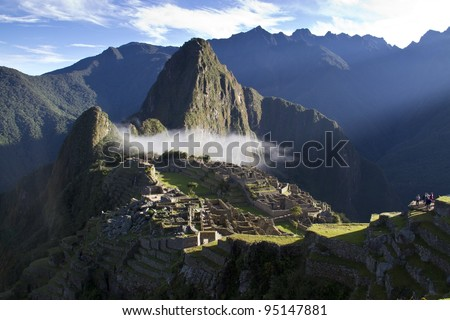 Machu Picchu at sunrise with clouds