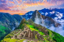 Machu Picchu, Cusco,Peru: Overview of the lost inca city Machu Picchu, agriculture terraces and Wayna Picchu, peak in the background,before sunrise